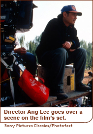 Director Ang Lee goes over a scene on the film's set.