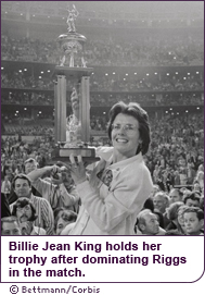 Billie Jean King holds her trophy after dominating Riggs in the match.