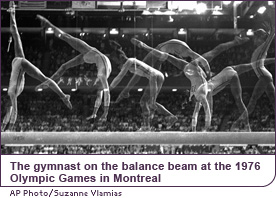 The gymnast on the balance beam at the 1976 Olympic Games in Montreal