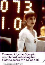 Comaneci in front of the Olympic scoreboard indicating her historic score of 10.0, as 1.00