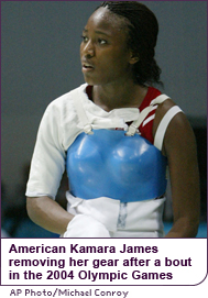 American Kamara James removes her gear after a bout in the 2004 Olympic Games