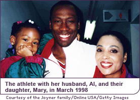 The athlete with her husband, Al, and their daughter, Mary, in March 1998