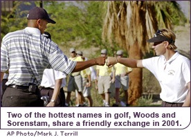 Two of the hottest names in golf, Sorenstam and Woods, share a friendly exchange in 2001.