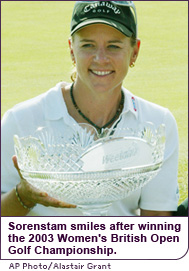The golfer holds her trophy for winning the 2003 Women's British Open Golf Championship.