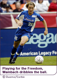 Playing for thte Freedom, Wambach dribbles the ball.