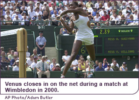 Venus closes in on the net during a match at Wimbledon in 2000.