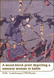 A wood-block print depicting a samurai woman in battle